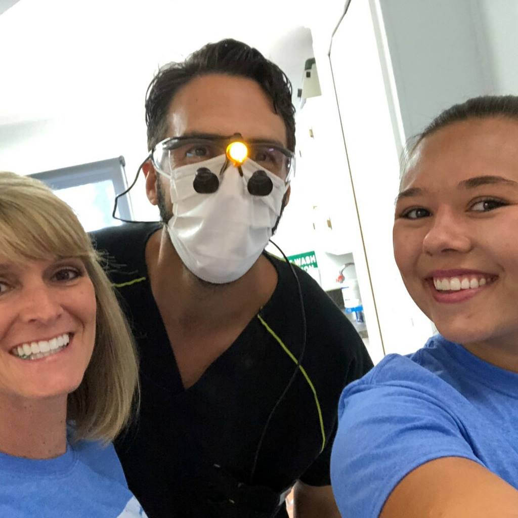 Roeder Orthodontics staff members with a local dentist