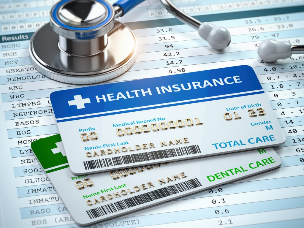 Health Insurance cards total and dental care with stethscope