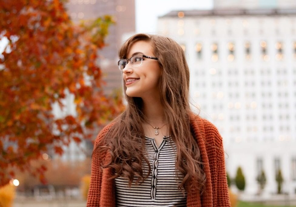 Picture of woman with braces in a city during autumn.
