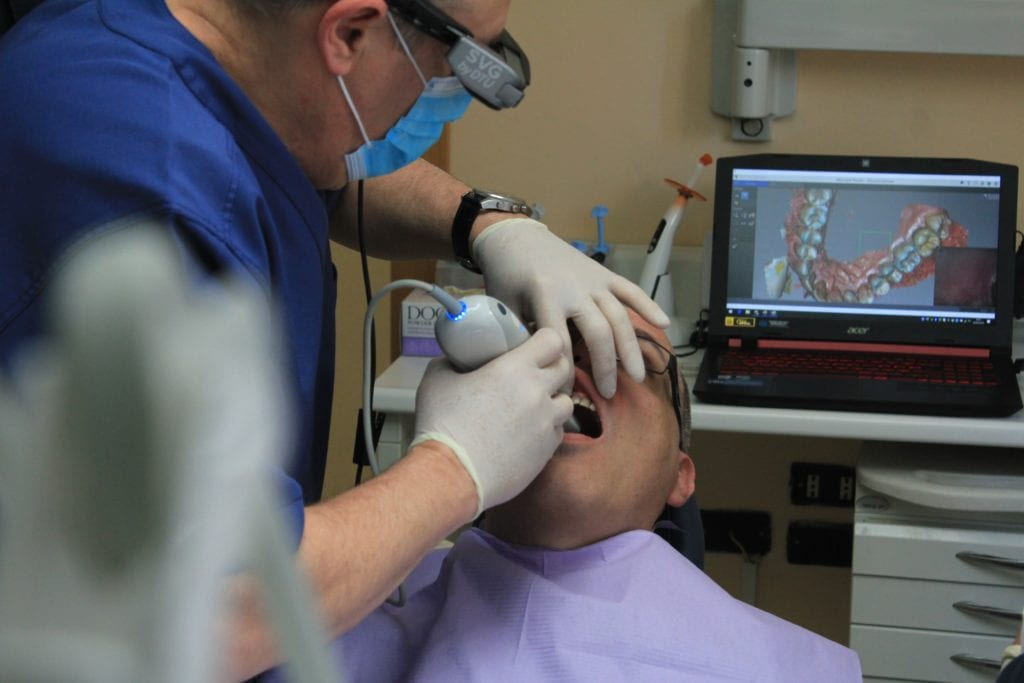 image of dentist taking digtal images of patient's teeth