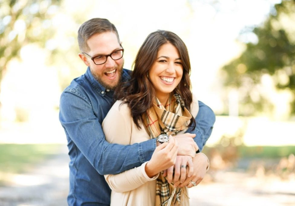 portrait of smiling couple on a sunny day