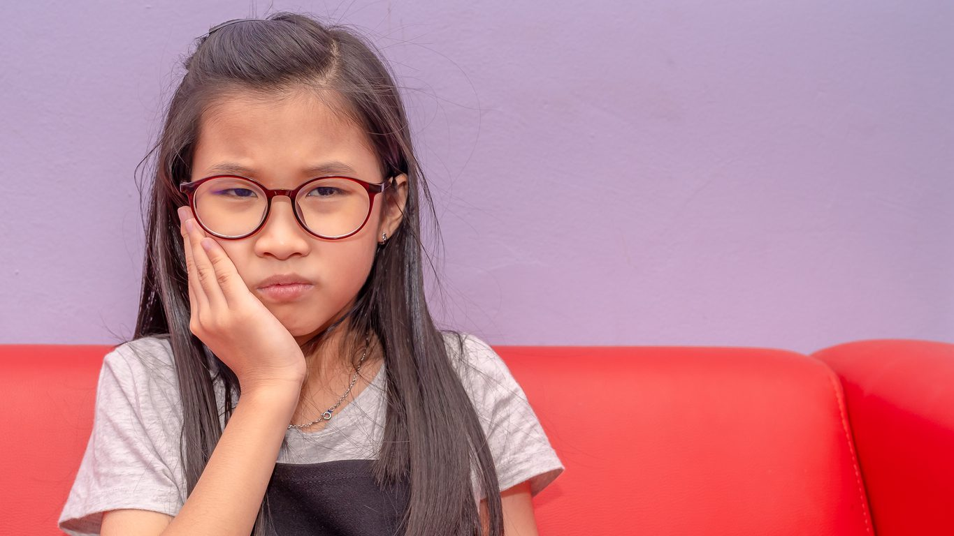 Photo of an Asian girl having toothache